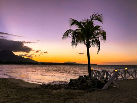 Sunset in yellow and purple shades with a reflection in the sea, Puerto Plata, Dominican Republic, Caribbean Stock Photo