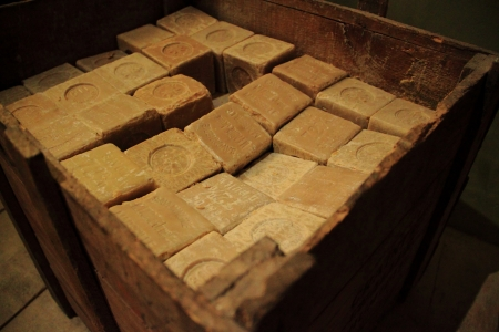 A wooden box full of raw soap of Marseille