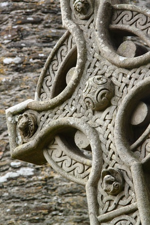 irish symbols: An old celtic cross in a traditional graveyard