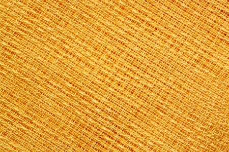 Pattern of yellow fabric with a loose weave photo