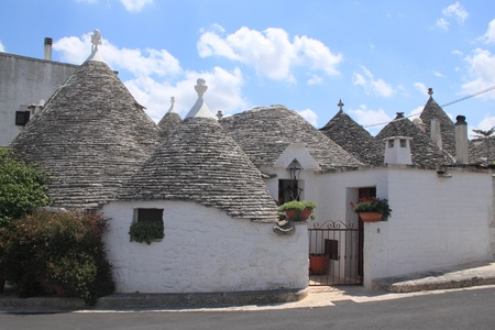 View of a group trulli building in alberobello (traditional conic houses built in stone)
