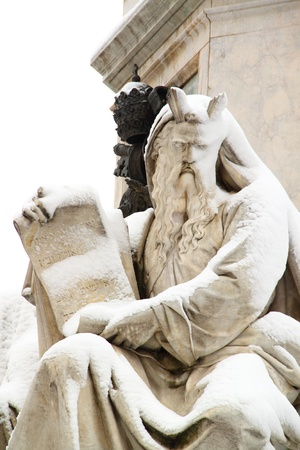 ancient scroll: A marble statue covered by snow in Rome, near Piazza di Spagna