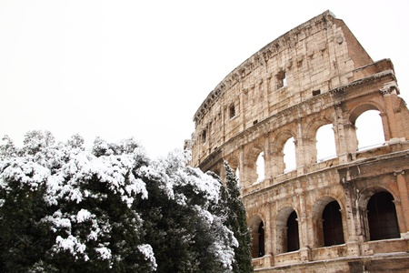The Coliseum covered by snow, a really rare event in Rome photo