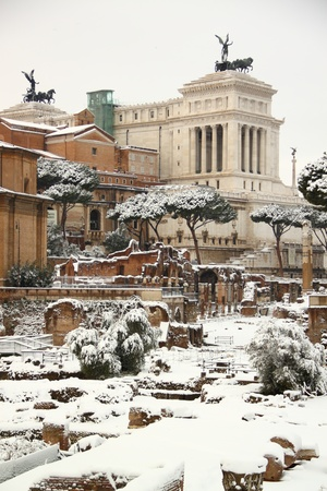 The Roman Forum covered by snow, a really rare event in Rome. In the background the Altar of Motherland