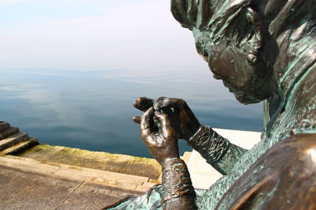 Bronze statue of a seamstress working with a thread Stock Photo - 13131461