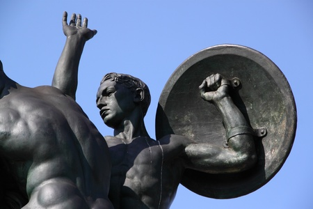 A bronze statue of a young soldier with a shield, on a blue sky background Stock Photo - 13007432
