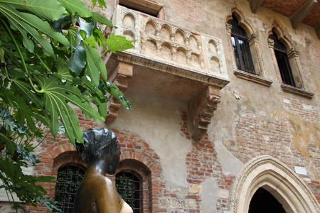 juliets: Bottom view of Juliets balcony with Juliets statue, from Verona, Italy