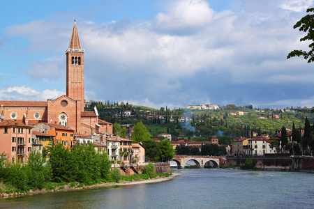 View of the Adige River and the San Fermo Church in Verona, Italy.