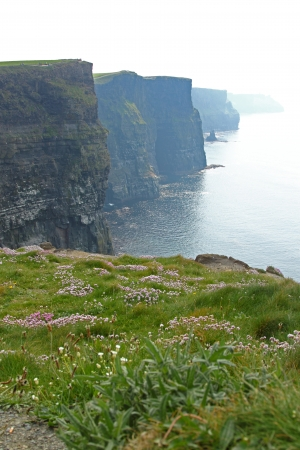 The Cliffs of Moher (Ireland) surrounded by fog Stock Photo