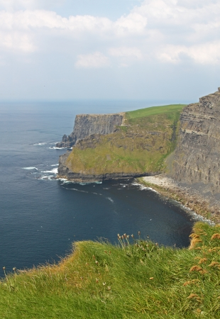 The Cliffs of Moher (Ireland) on a day of mist Stock Photo