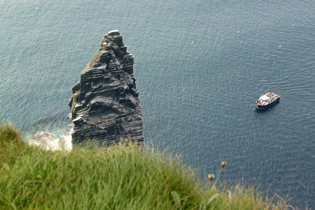 The Cliffs of Moher (Ireland) with a boat photo