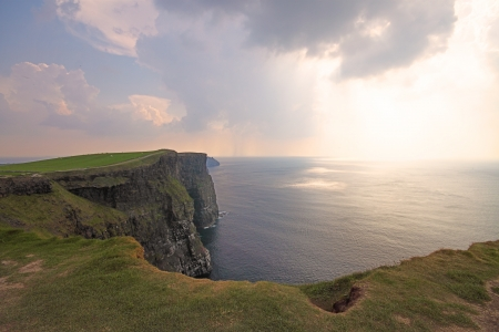 connemara: The Cliffs of Moher (Ireland)  in a misty day at dusk
