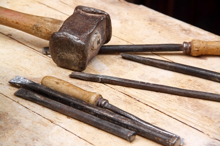 medieval blacksmith: Set of hammer and chisels for woodworking