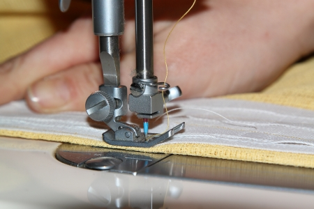 Tailor working with a sewing machine photo