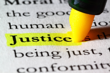 Word justice highlighted with a yellow marker Stock Photo - 17174295