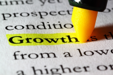 Word growth highlighted with a yellow marker Stock Photo - 17174302