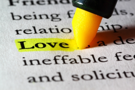 Word love highlighted with a yellow marker Stock Photo - 17174296