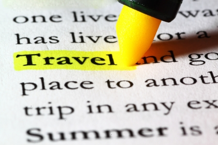 Word travel highlighted with a yellow marker Stock Photo - 17174293