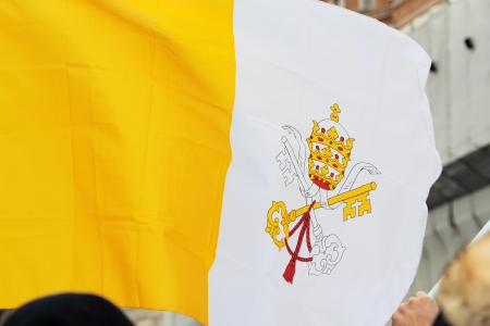 ROME, ITALY - March 17: A flag of Vatican City in St. Peter Square before the first Angelus prayer of Pope Francis I on March 17, 2013 in Vatican City, Rome, Italy Editorial