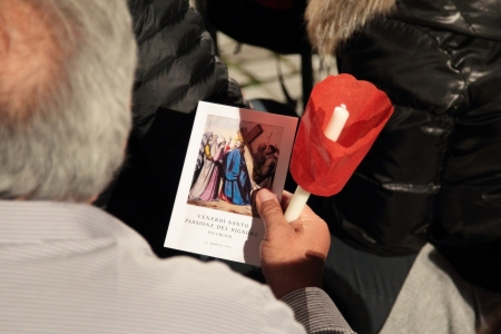 chaired: 29th March 2013, Colosseum Square, Rome: A pilgrim is reading the booklet of prayers, waiting for the Stations of the Cross chaired by the Pope Francis I around the coliseum on Good Friday.