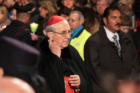 chaired: 29th March 2013, Colosseum Square, Rome: A cardinal is walking through the crowd during the Stations of the Cross chaired by the Pope Francis I around the coliseum on Good Friday. Candles are lit. Editorial