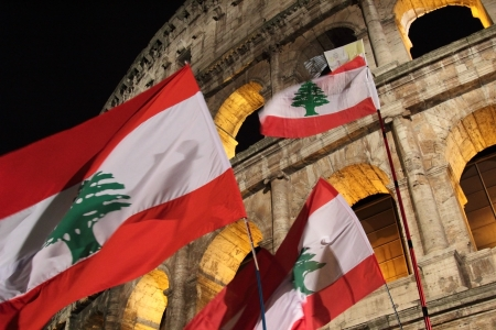 chaired: 29th March 2013, Colosseum Square, Rome: Several flags of Lebanon are waving in front of the coliseum. The meditations read during the Stations of the Cross chaired by the Pope Francis I around the coliseum on Good Friday, were written by young Lebanese C