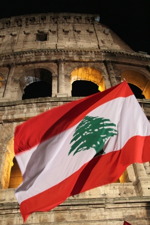 chaired: 29th March 2013, Colosseum Square, Rome: A flag of Lebanon is waving in front of the coliseum. The meditations read during the Stations of the Cross chaired by the Pope Francis I around the coliseum on Good Friday, were written by young Lebanese Catholics