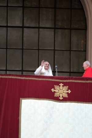homily: ROME, ITALY - April 07: Pope Francis I during the settlement ceremony in Archbasilica of St. John Lateran. After the mass the Pope appeared at the central chapel. A gust of wind lifted the cloak over its head
