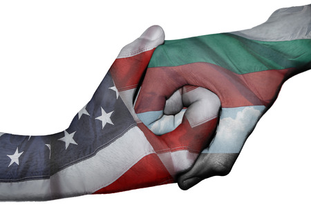 Diplomatic handshake between countries: flags of United States and Bulgaria overprinted the two hands