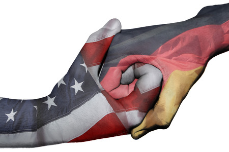 diplomatic: Diplomatic handshake between countries: flags of United States and Germany overprinted the two hands Stock Photo