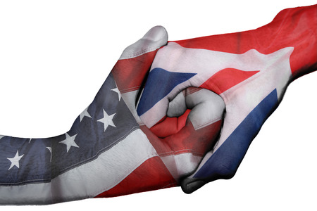 diplomatic: Diplomatic handshake between countries: flags of United States and United Kingdom overprinted the two hands
