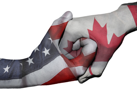 negotiating: Diplomatic handshake between countries  flags of United States and Canada overprinted the two hands