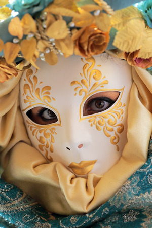 concealed: A woman with large eyes concealed by a mask exhibited during the traditional Carnival of Venice, Italy  2014 edition
