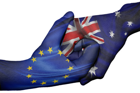 trade union: Diplomatic handshake between countries: flags of European Union and Australiaoverprinted the two hands Stock Photo