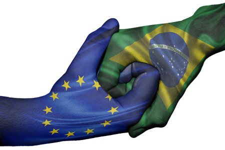 Diplomatic handshake between countries: flags of European Union and Braziloverprinted the two hands photo