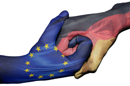 Diplomatic handshake between countries: flags of European Union and Germany overprinted the two hands photo