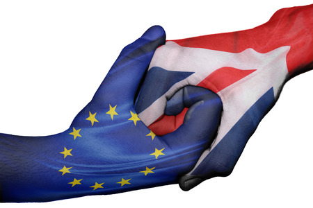 great britain flag: Diplomatic handshake between countries: flags of European Union and Great Britain overprinted the two hands