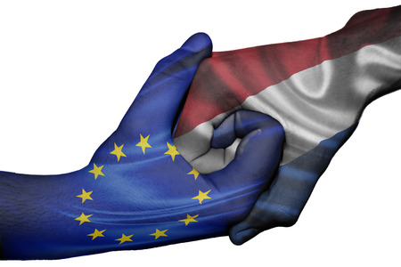 Diplomatic handshake between countries: flags of European Union and Netherlands overprinted the two hands photo