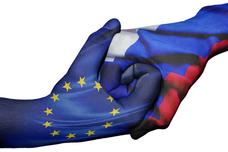 diplomatic: Diplomatic handshake between countries: flags of European Union and Russiaoverprinted the two hands