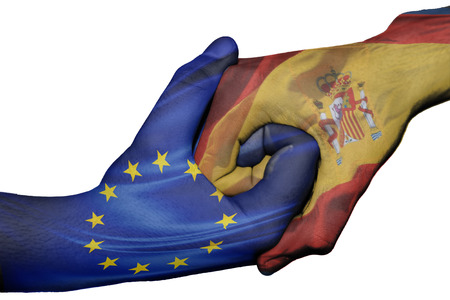 trade union: Diplomatic handshake between countries: flags of European Union and Spainoverprinted the two hands