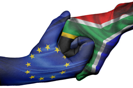Diplomatic handshake between countries: flags of European Union and South Africa overprinted the two hands photo