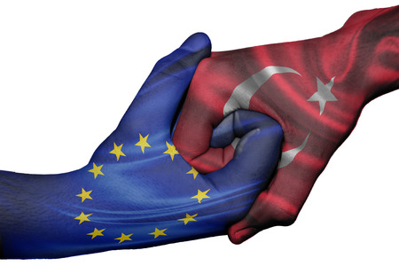 Diplomatic handshake between countries: flags of European Union and Turkey overprinted the two hands Stock Photo