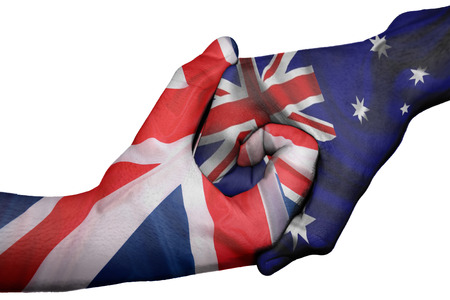 Diplomatic handshake between countries: flags of United Kingdom and Australiaoverprinted the two hands
