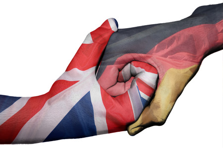 diplomatic: Diplomatic handshake between countries: flags of United Kingdom and Germany overprinted the two hands