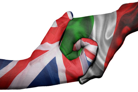 trade union: Diplomatic handshake between countries: flags of United Kingdom and Italyoverprinted the two hands