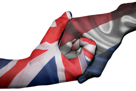 Diplomatic handshake between countries: flags of United Kingdom and Netherlands overprinted the two hands photo