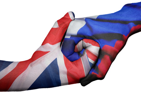 trade union: Diplomatic handshake between countries: flags of United Kingdom and Russia the two hands