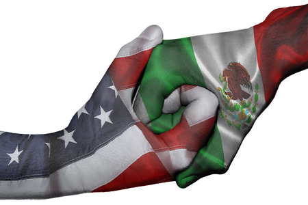 Diplomatic handshake between countries: flags of United States and Mexico overprinted the two hands