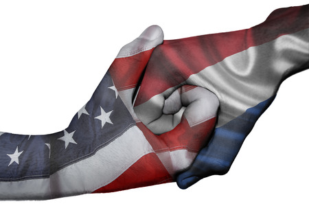 Diplomatic handshake between countries: flags of United States and Netherlands overprinted the two hands photo