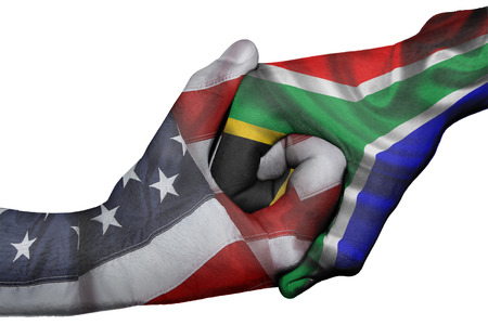 trade union: Diplomatic handshake between countries: flags of United States and South Africa overprinted the two hands